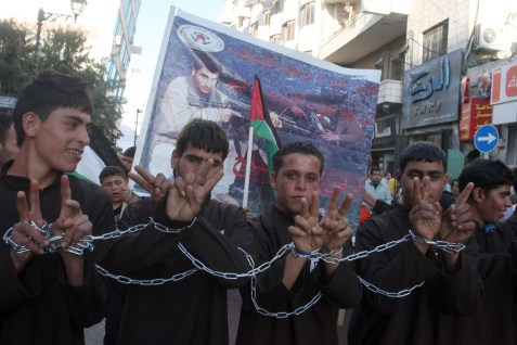 Palestinians in Ramallah take part in a rally in support of Palestinian prisoners holding a hunger strike in Israeli prisons