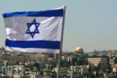 The Flag of Israel flying in Jerusalem with the Temple Mount in the distance