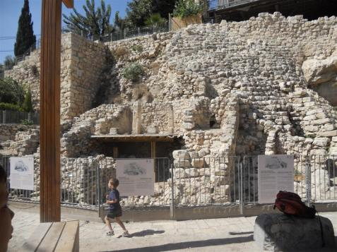 "Child walking by the ""Stepped Stone Structure"" possibly an Israelite royal palace in continuous use from the tenth century until 586 BCE."
