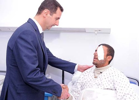 President al-Assad Visits an injured soldier in a Damascus hospital. This may have to be their last good bye.