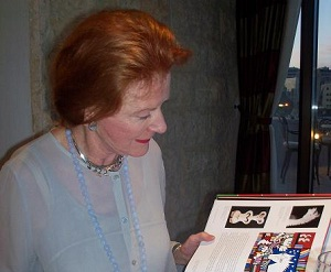 Edwina Sandys in Jerusalem with her book detailing her artwork and sculptures.