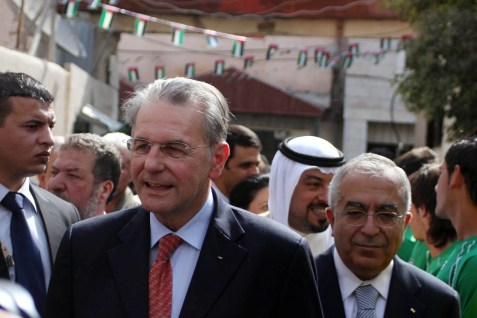 International Olympic Committee President Jacques Rogge visits the Amari refugee camp near Ramallah