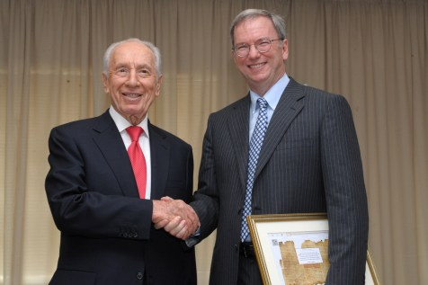 Israeli president Shimon Peres meets with executive chairman of Google, Eric Schmidt at the President's conference.
