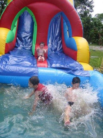 Neytz campers enjoy a slippery water slide.
