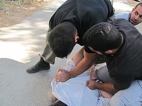 Beaten and cuffed, no warrant