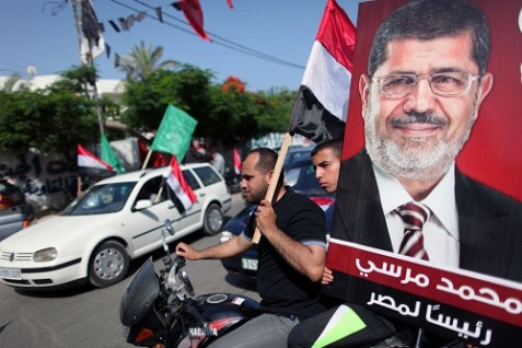 Palestinian supporters of Hamas and the Muslim Brotherhood's presidential candidate Mohammed Morsi celebrate his victory in Gaza City.