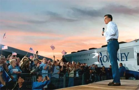 Mitt Romney in front of his campaign bus.