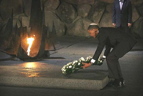 Has it been 4 years already? Democratic presidential candidate Barack Obama lays a wreath at Yad Vashem in Jerusalem, July, 2008.