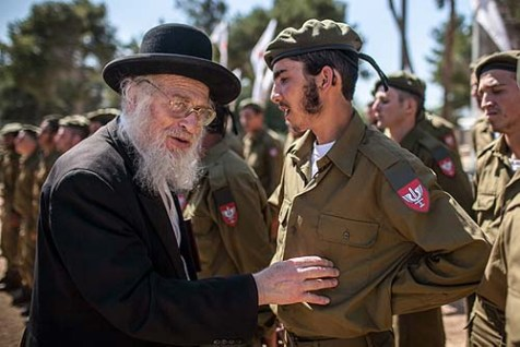 "Rabbi Yoel Schwartz greets Religious Jewish soldiers attending a swearing in ceremony as they enter the IDF ""Nahal Haredi"" unit. May 31, 2012."