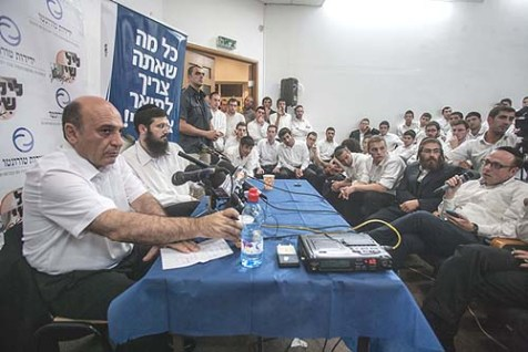 "Kadima chairman Shaul Mofaz met with Haredi students at Beit Ariel Yeshiva in Jerusalem. last week, to discuss his proposed ""equal share of the burden."""