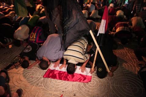 Praying on the Egyptian flag