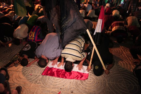 Praying on the Egyptian flag