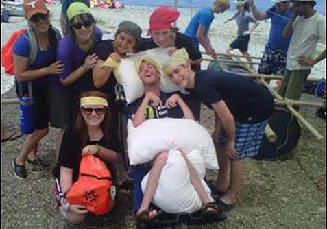 Zack Pollack (center) in his special wheelchair, joins his new friends to build rafts on the beach at the Sea of Galilee, as part of Yad B'Yad.