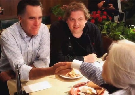 Candidate Romney at a diner with potential voter. There will be no dinner at his Tisha B&#039;Av fundraiser in Jerusalem.