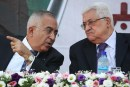 PA Prime Minister Salam Fayyad (R) and President Mahmoud Abbas