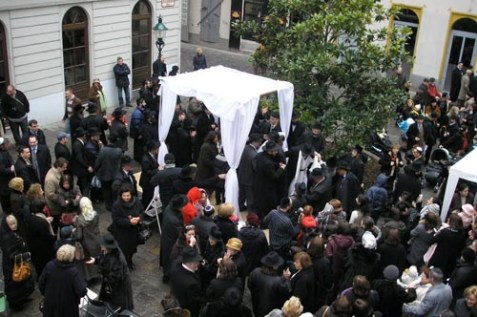 Photo: Orthodox Jewish wedding with chupah in Vienna.