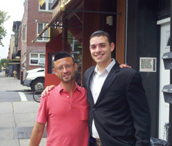 Moshe Tischler campaigning on 16th Avenue with Laizer Lichtenstein, a local business owner.