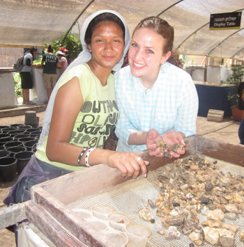 Yael Selter of Wesley Hills, NY (right) poses with a camper from Dimona while sifting through pottery shards at an archeological dig site in Jerusalem.