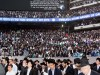 Participants in the MetLife Stadium Siyum HaShas recite the Minchah prayer.