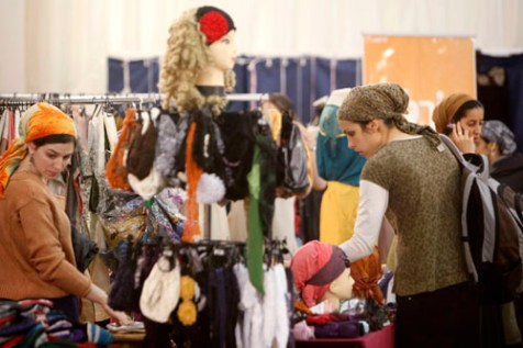 Orthodox Jewish women enjoy shopping at a clothing fair for women only, held at the International Conference Center in jerusalem. March 27, 2012.