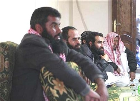Salafi Bedouin tribesmen at a council tribunal, where Islamic Sharia laws are used to resolve disputes between tribes, in North Sinai.
