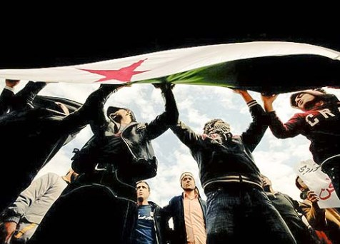Sunni Muslim Salafists holding the Syrian opposition flag during a demonstration.