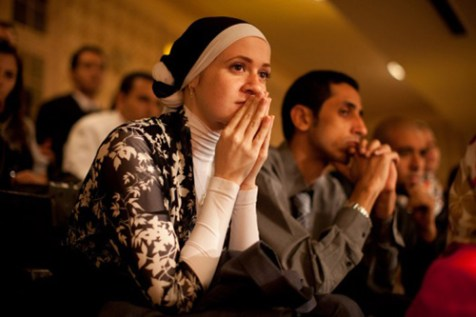 "Egyptian students listening to President Barack call for ""new beginning between the United States and Muslims"" at Cairo University in Cairo, Thursday, June 4, 2009."