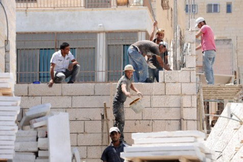 Palestinian construction workers in the Jewish neighborhood of Jerusalem, Ramat Shlomo.