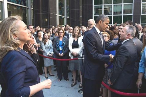 President Barack Obama greets State Department employees after Chris Stevens, U.S. Ambassador to Libya, and three others had been killed in Benghazi, Libya, on Sept. 11. Secretary of State Hillary Rodham Clinton stands at left.