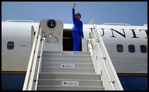 Secretary Clinton waving.