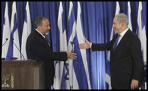 Israeli Prime Minister Benjamin Netanyahu of the Likud (R) and Foreign Minister Avigdor Liberman of Yisrael Beitenu announced their two parties' joining forces ahead of the upcoming Israeli general elections.