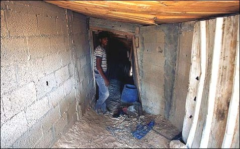 A Palestinian smuggler in a tunnel beneath the Egyptian-Gaza border in Rafah.