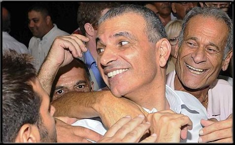 Minister of Communications, Welfare & Social Services Moshe Kahlon embraced and congratulated by Likud members.