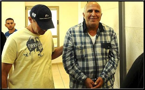 Charlie Abutbul being led to an arraignment at the Rishon Letzion court, October 31.