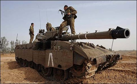 Israeli soldiers along the border are preparing their tanks for a possible ground operation inside the Gaza Strip.