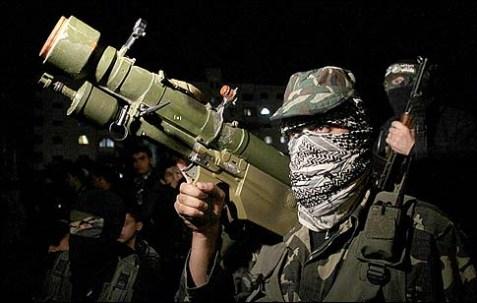 Gunmen from the Ezzedine al-Qassam Brigades, the armed wing of Hamas, in Gaza City on November 22, 2012.