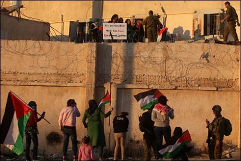 A group of Palestinian girls managed to climb over a building in the Israeli town of Beit El