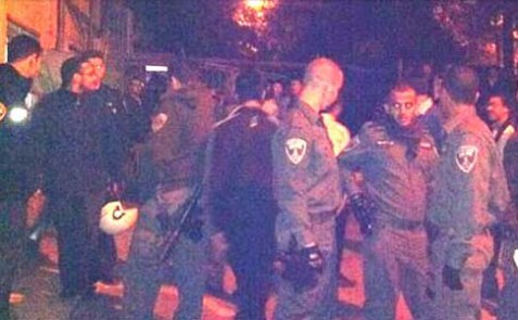 Police crowded the street outside the house of ill repute in a Haredi neighborhood in Jerusalem.