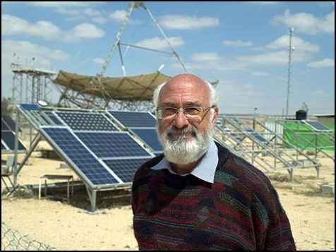 David Faiman of the National Solar Energy Center in front of the world&#039;s largest solar parabolic dish, in the Negev.
