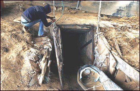 An Arab working outside a smuggling tunnel connecting the Gaza Strip and Egypt in Rafah, southern Gaza Strip.