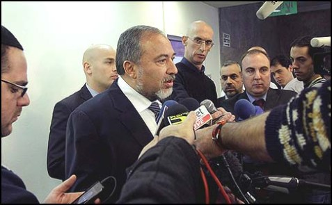 FM Liberman speaking to the media outside the weekly government meeting in Jerusalem, Dec. 16, 2012.