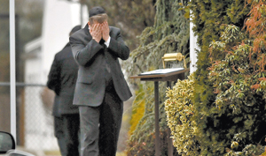 Guest shows his emotions outside the Abraham L. Greene & Son Funeral Home in Fairfield, Connecticut before funeral service Monday for Noah Pozner, youngest of the Newtown massacre victims.