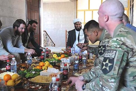 Farah province Chief Justice Shams Ur-Rahman, center, shared a laugh with civilian and military members of Provincial Reconstruction Team Farah during a luncheon meeting at his office in Farah, Afghanistan, Nov. 29, 2012.