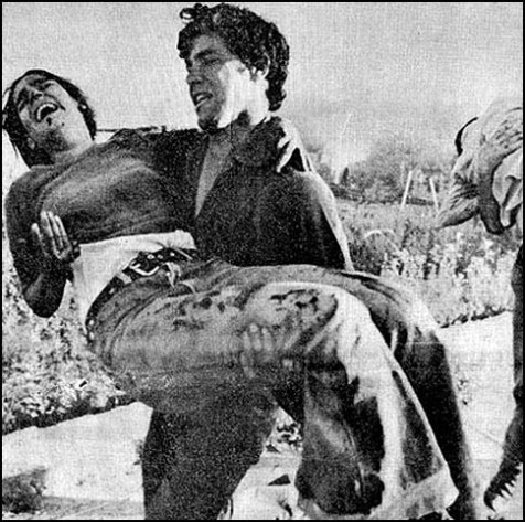 Tzipi Maimon-Bokris is saved by her brother after being injured by a grenade at the Netiv Meir school building in Ma'alot, Israel, May 15, 1974.
