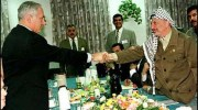 Netanyahu shaking Arafat's hand upon handing the Palestinians most of Hebron.