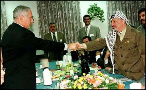 Netanyahu shaking Arafat&#039;s hand upon handing the Palestinians most of Hebron.