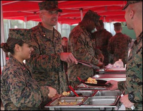 U.S. Marine Corps senior leadership, with Marine Aviation Logistics Squadron (MALS) 16, serve eggs, sausage and pancakes for a breakfast .