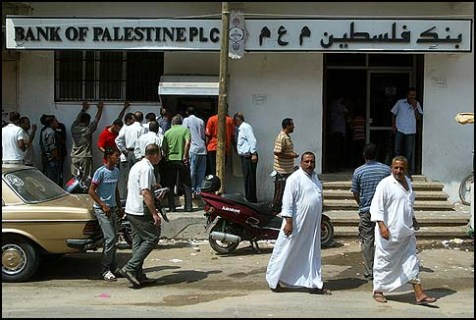 A crowds of Palestinians waiting in front of an ATM macine in the southern Gaza Strip.