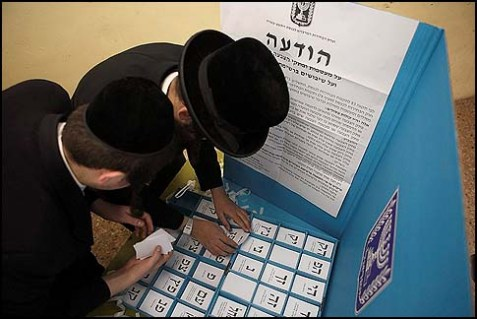 Haredi men cast their votes for the 19th Knesset in Bnei Brak, January 22 2013.