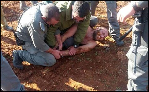 Border Policemen, many of whom are Druze, beating up a Jewish civilian in Esh Kodesh.